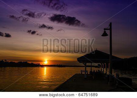 Sun Setting Over the Lake at the Wharf