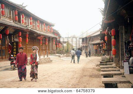Tourists Walking In Shuhe Ancient Town.