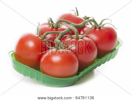 Fresh Tomatoes Isolated On White Background In Green Tray