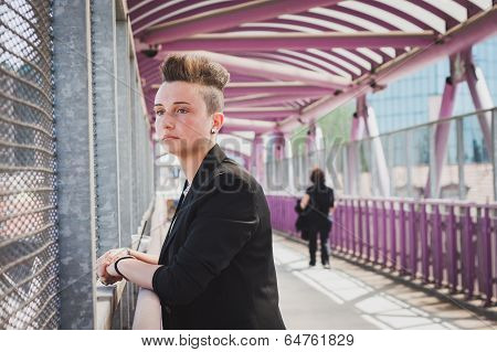 Pretty Short Hair Girl Posing On A Bridge
