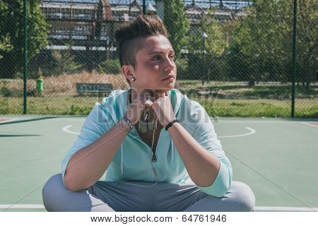 Short Hair Girl In A Basketball Playground