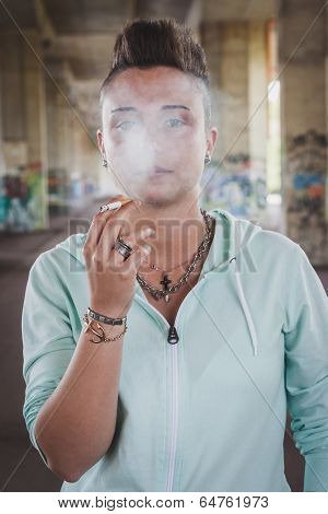 Portrait Of Short Hair Girl With Hoodie Smoking