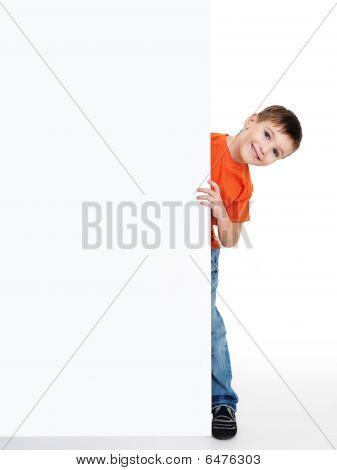 Little Boy Look Outs From The Blank Billboard