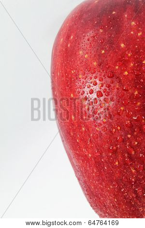 Red Apple In Drops Of Water