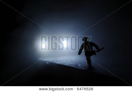 Firefighter Run Onto The Car Lights In The Mist