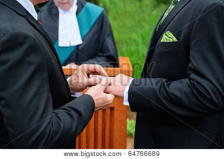 Two Men Exchanging Rings