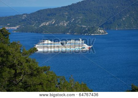 MARMARIS, TURKEY - APRIL 17, 2014: Cruise ship AIDAdiva exit from the bay of Marmaris. AIDA ships cater to the German-speaking market, and has 94% average guests satisfaction rate