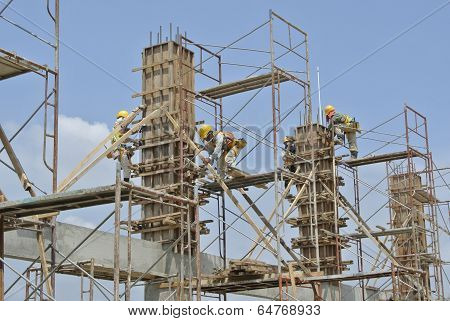 Construction workers fabricating column formwork