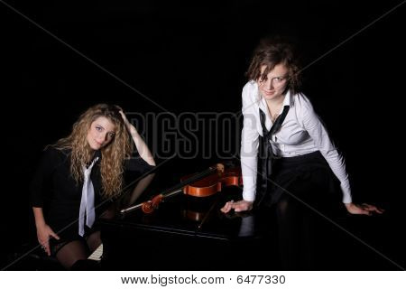 Two Beautiful Young Women With Violin And Piano
