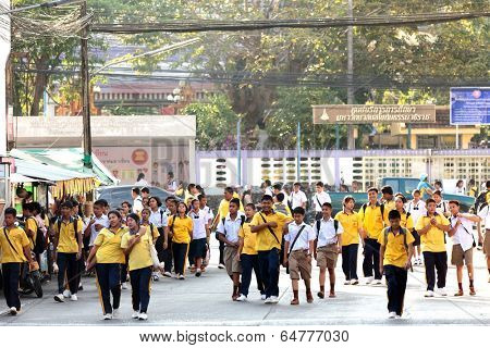 PHANG NGA, THAILAND, JANUARY 27: Thai student are going back home in the evening in the street of Phang Nga village, Thailand, on Januray 27, 2014.
