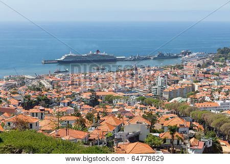 Aerial View Of Portugese Funchal With A Big Cruise Ship In The Harbor