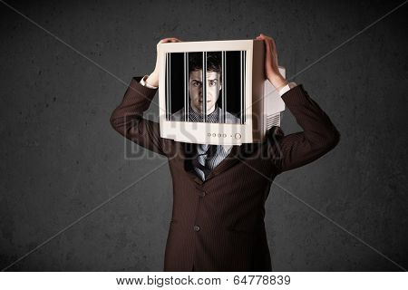 Business man with monitor screen on his head traped into a digital system concept