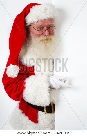 Santa Pointing At Banner