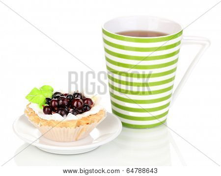 sweet cake with cup of tea isolated on white