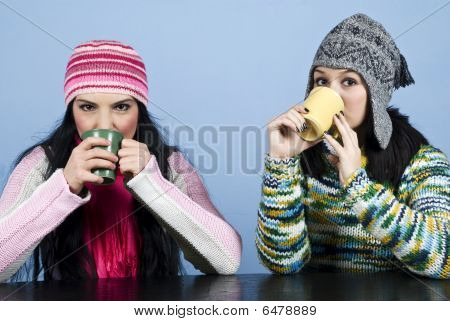Two Women Drinking  Hot Drink