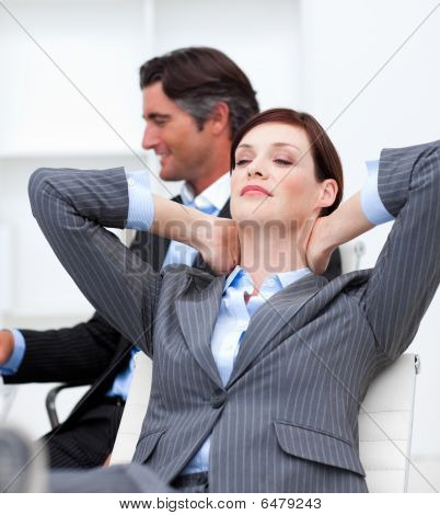 Businesswoman Sleeping With Feet On Desk