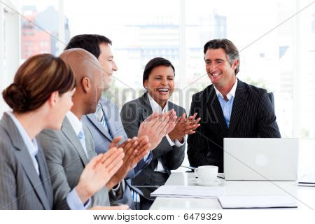 Smiling Multi-ethnic Business Team Applauding