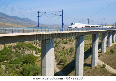 view of a high-speed train crossing a viaduct in Saragossa province, Aragon, Spain, AVE Madrid Barcelona.