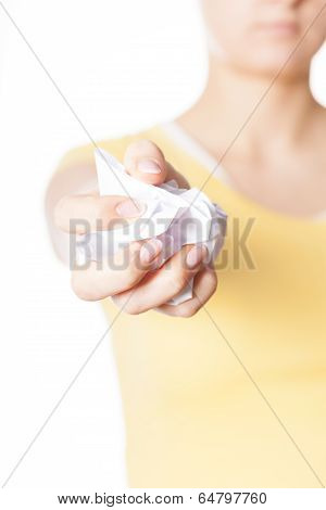 Woman Squeezing Piece Of Paper