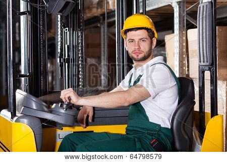 Storehouse Employee Driving On Forklift