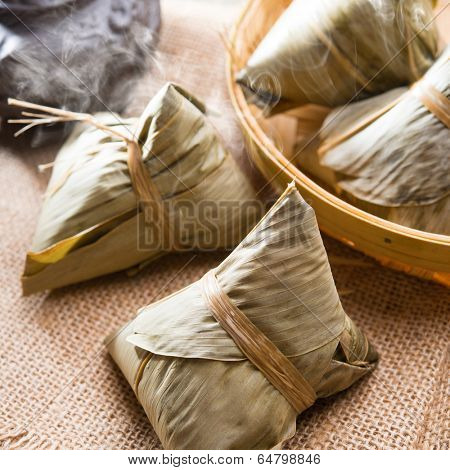 Traditional steamed sticky glutinous rice dumplings. Hot rice dumpling or zongzi. Chinese food dim sum. Asian cuisine.