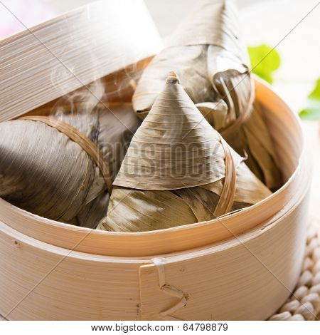 Hot rice dumpling or zongzi. Traditional steamed sticky glutinous rice dumplings. Chinese food dim sum. Asian cuisine.