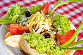 stock photo of tacos  - Taco salad with lettuce guacamole cheddar cheese and chicken - JPG