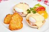 stock photo of benediction  - Eggs Benedict with two halves of an English muffin balyk eggs and Hollandaise sauce - JPG
