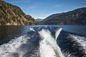 image of outboard  - Trace motor boats on the water of a mountain lake - JPG