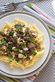 foto of morels  - Spiral pasta with morel mushrooms on a plate - JPG