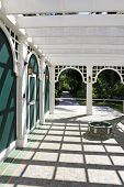 stock photo of pergola  - View of attached white pergola with archs and columns - JPG