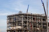 stock photo of lng  - Liquefied natural gas Refinery Factory with LNG storage tank using for Oil and gas industry