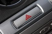 stock photo of flashers  - Car hazard warning flashers button with visible red triangle - JPG