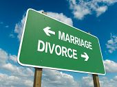 foto of crossroads  - Road sign to marriage or divorce with blue sky - JPG