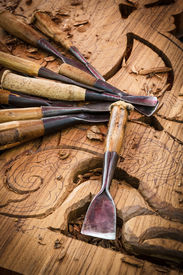 picture of woodcarving  - Vintage woodworking tools on the traditional Thai woodcarver. ** Note: Shallow depth of field - JPG