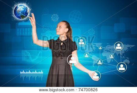 Beautiful businesswoman in dress pointing finger on network and Earth
