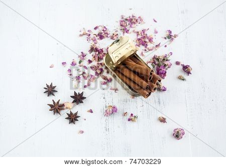 Tin Can With Pink Flowers And Cinnamon Sticks