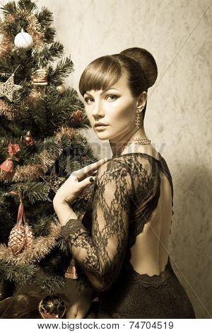 Beautiful woman with Christmas tree- vintage card