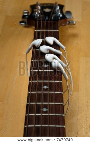 Earbuds As Fingers On Guitar