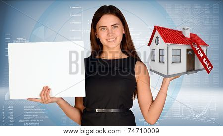 Businesswoman holding empty paper and house