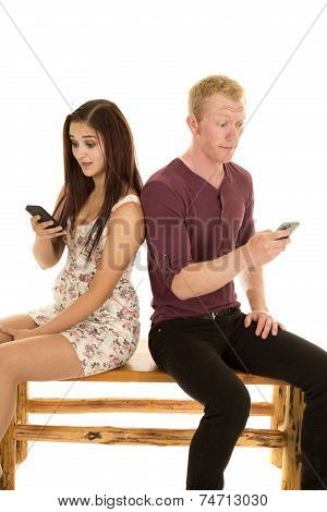 Man Woman Sit Back To Back Phones Surprised