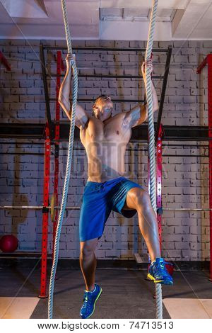 Climb with two 2 ropes exercise man workout at gym