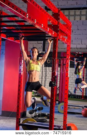 Toes to bar woman pull-ups 2 bars workout gym