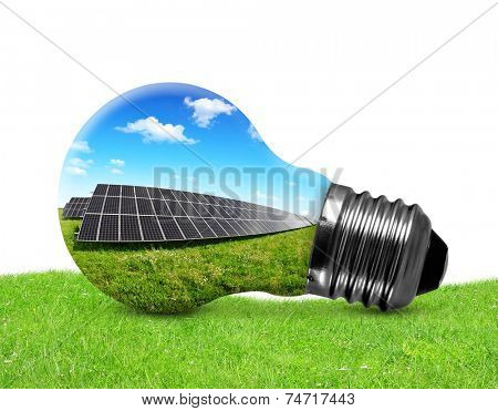 Solar panels in light bulb on white background. Green energy concept.