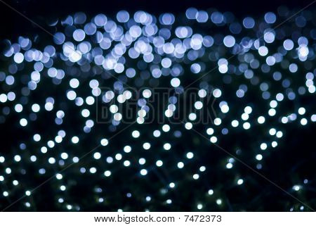 Defocused Blue Light Dots Against Black Background