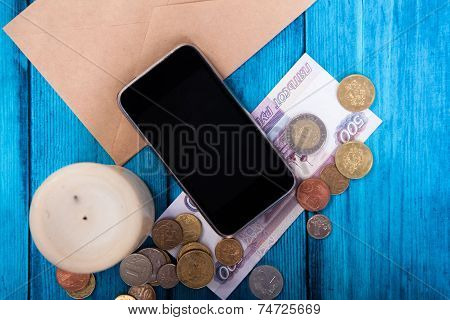 Marine Theme Blue Background. Trendy Gadget And Money From The Mail Envelope