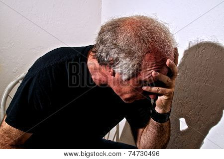 Distressed Man  Holding Head