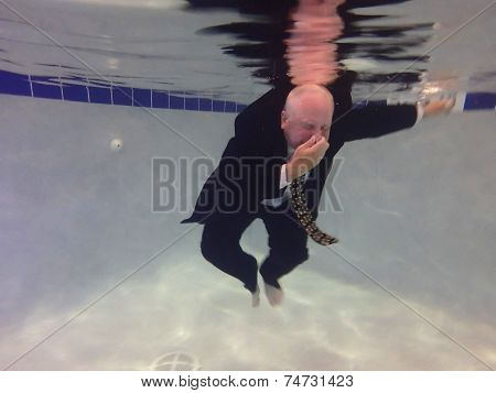 Businessman Holding Nose Under Water