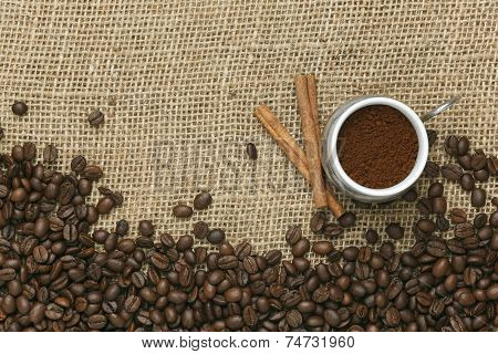 Caffe edition coffee beans on Jute background