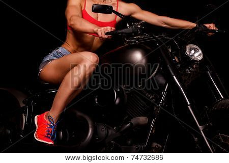 fit woman on a bike